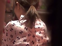 Asian in pajamas rubbing
